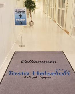 Logomatte Tasta Helseloft